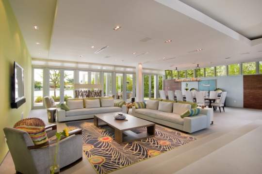 Wide Angle View Of Living And Dining Areas